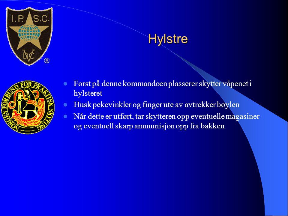 Hylstre Først på denne kommandoen plasserer skytter våpenet i hylsteret. Husk pekevinkler og finger ute av avtrekker bøylen.