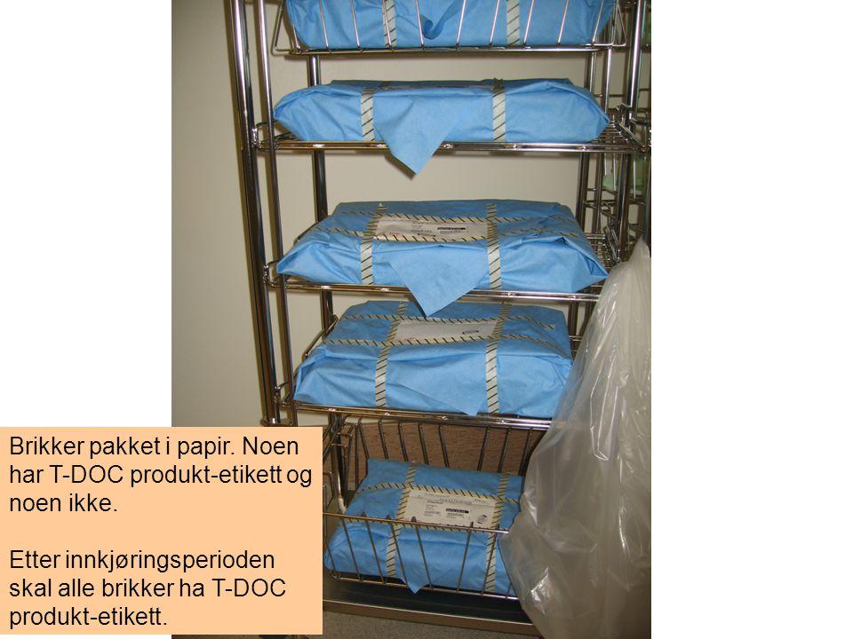 Brikker pakket i papir. Noen har T-DOC produkt-etikett og noen ikke.