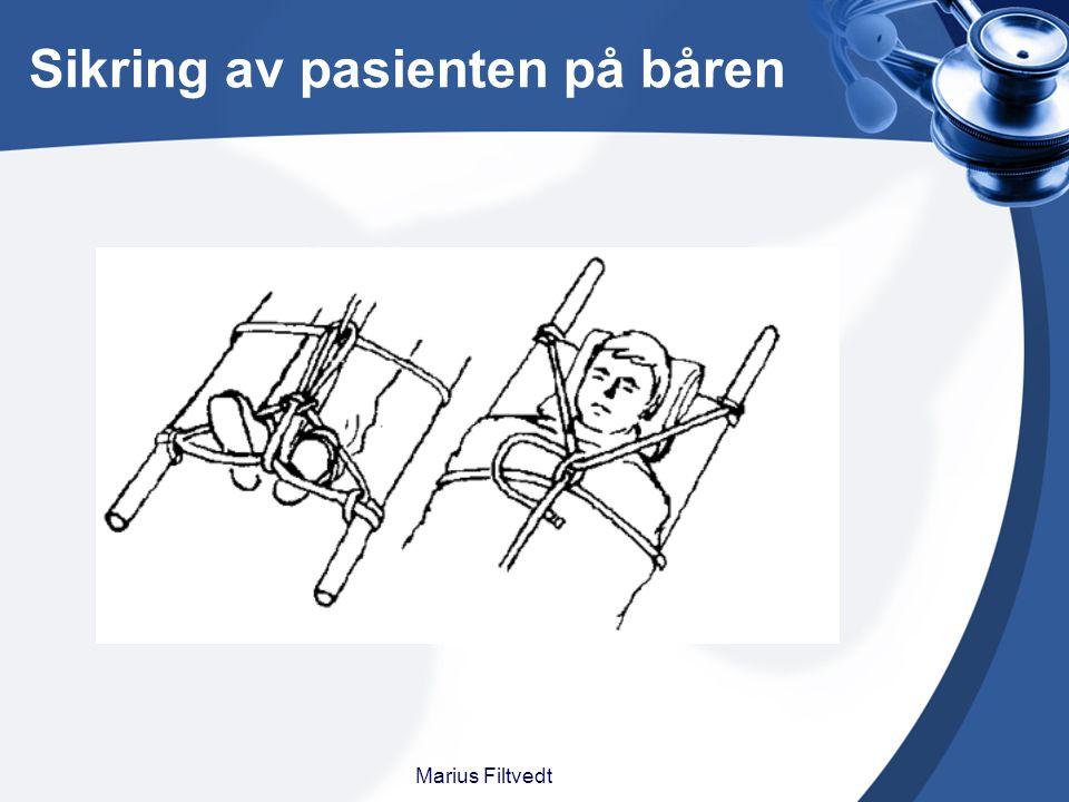 Sikring av pasienten på båren