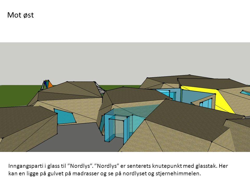 Mot øst Inngangsparti i glass til Nordlys . Nordlys er senterets knutepunkt med glasstak. Her.