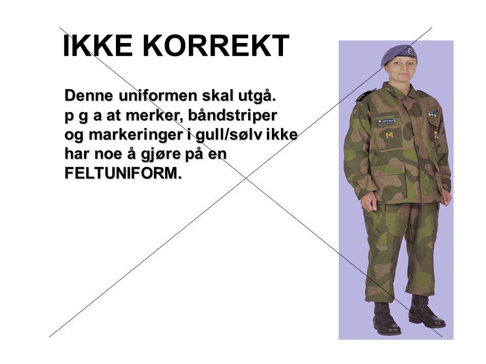 IKKE KORREKT Denne uniformen skal utgå. p g a at merker, båndstriper