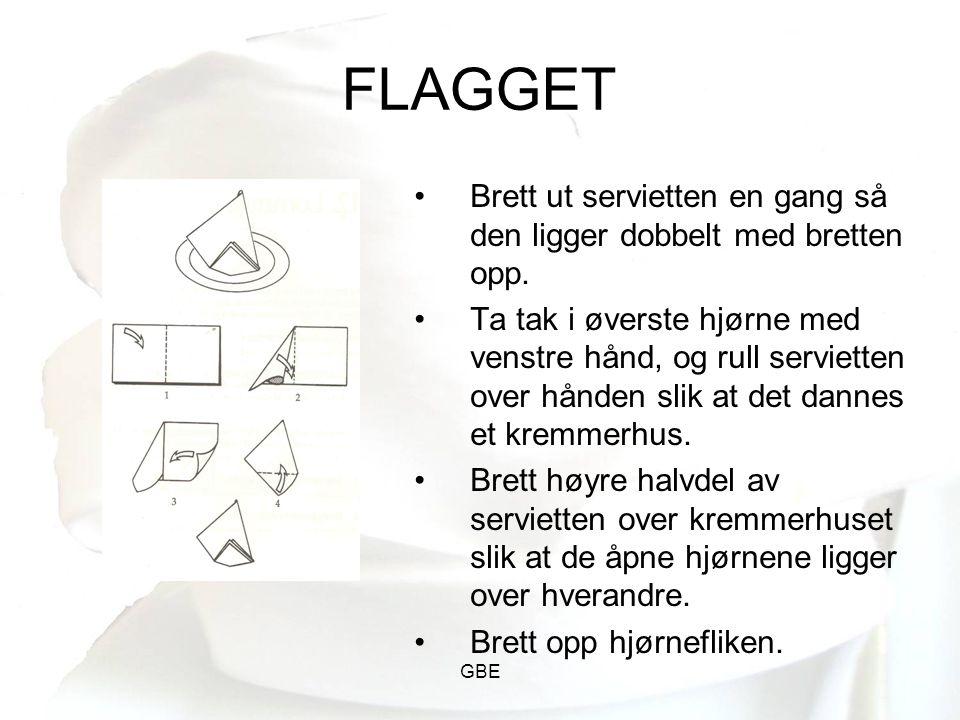 FLAGGET Brett ut servietten en gang så den ligger dobbelt med bretten opp.