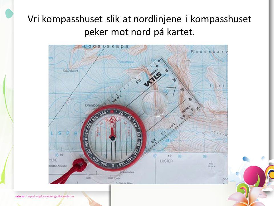 Vri kompasshuset slik at nordlinjene i kompasshuset peker mot nord på kartet.